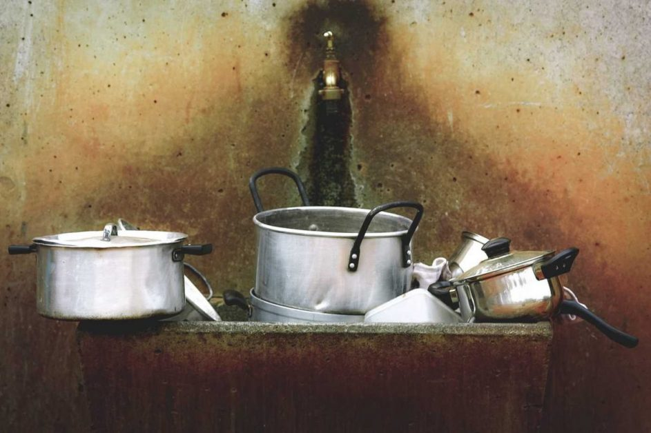 dirty pots and pans in sink