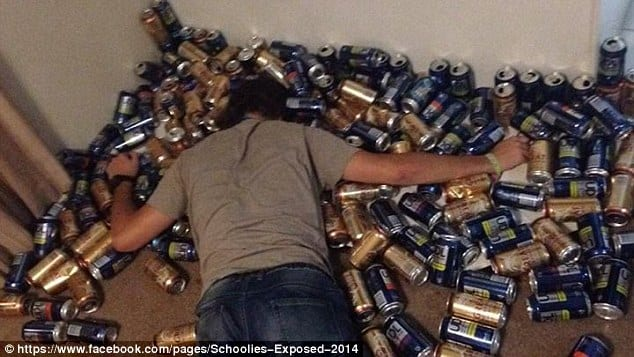 guy passed out in a pile of beer cans