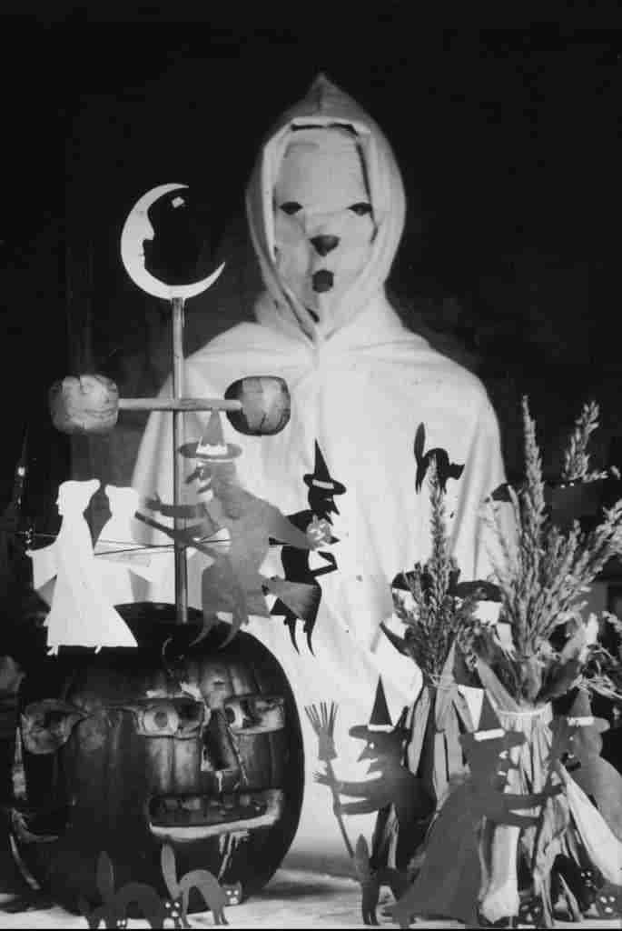 vintage halloween scene with masked person and jackolantern