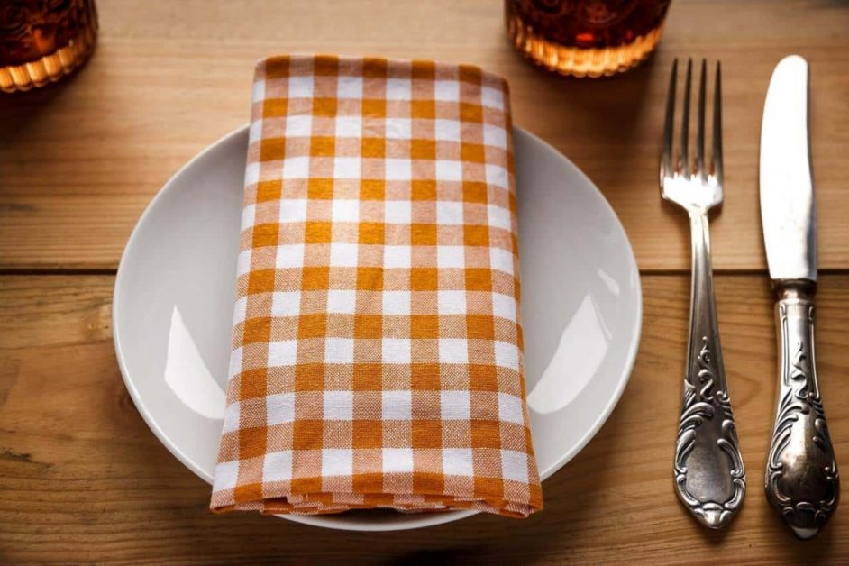 plate with checkered orange napkin on it for thanksgiving