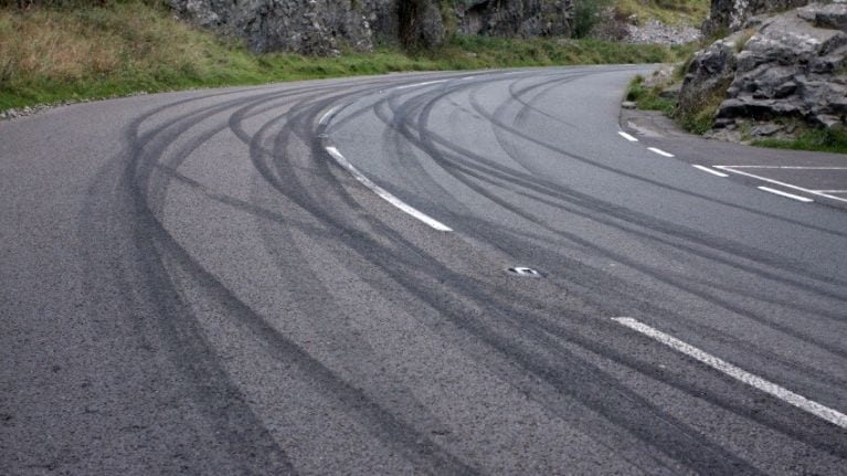 Paved road with lots of tire marks