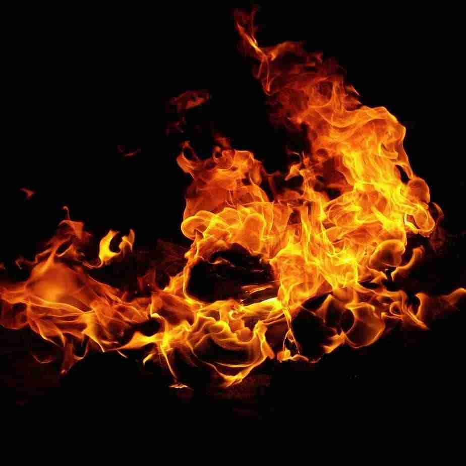 fire burining elderly set fire to kitchen