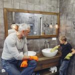 father with child cleaning bathroom