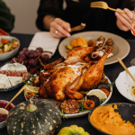 thanksgiving dinner on table with person eating