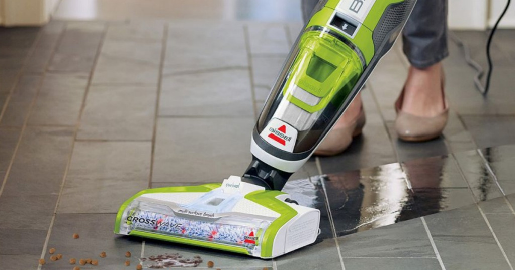 woman cleaning floor with bissell crosswave