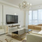 luxury living room with modern white and gold furniture