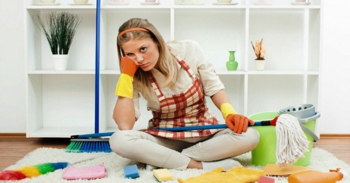 bad housekeeper surrounded by cleaning tools on floor