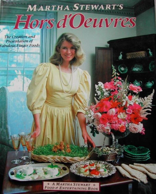 martha stewart 80s magazine cover she is posing in front of horderves on table
