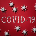 covid 19 microbes on red background