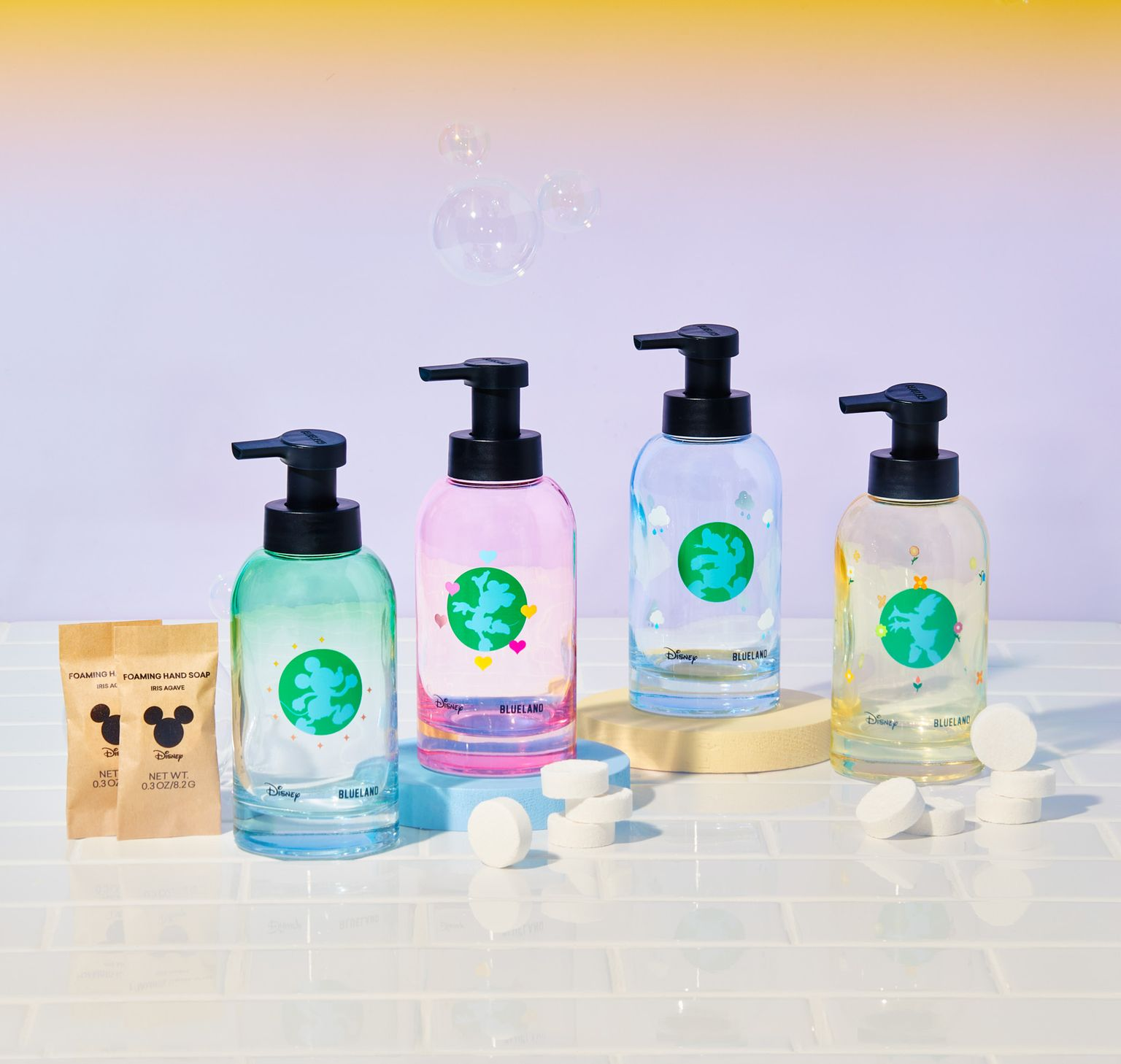four bottles of blueland hand soap with Mickie and minnie on it